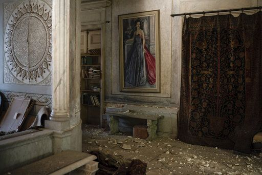 Debris from the ceiling and walls cover the floor of a room in the Sursock Palace, heavily damaged after the explosion in the seaport of Beirut, Lebanon, Friday, Aug. 7, 2020. The 150-year-old palace withstood two world wars, the fall of the Ottoman empire, the French mandate and Lebanese independence. After the country's 1975-1990 civil war, it took 20 years of careful restoration for the family to bring the palace back to its former glory.