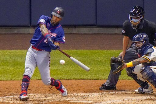 Minnesota Twins' Eddie Rosario hits a single during the fifth inning of a baseball game against the Milwaukee Brewers Monday, Aug. 10, 2020, in Milwaukee.
