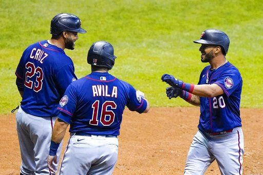 Minnesota Twins' Eddie Rosario celebrates his grand slam with Alex Avila (16) and Nelson Cruz (23) during the third inning of a baseball game against the Milwaukee Brewers Monday, Aug. 10, 2020, in Milwaukee.
