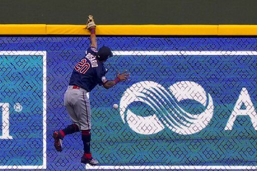 Minnesota Twins left fielder Eddie Rosario can't catch a double hit by Milwaukee Brewers' Orlando Arcia during the second inning of a baseball game Monday, Aug. 10, 2020, in Milwaukee.