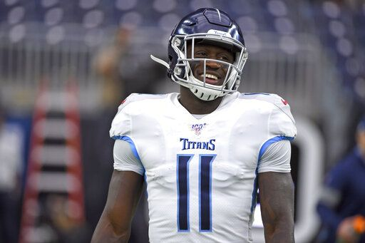 FILE - In this Dec. 29, 2019, file photo, Tennessee Titans' A.J. Brown (11) warms up before an NFL football game against the Houston Texans in Houston. Titans wide receiver A.J. Brown led all rookies in receiving yards despite working with quarterback Ryan Tannehill for only 10 games. Now Brown is going into his second season ready to show what he can do with a full 16-game schedule as Tennessee's top receiver.