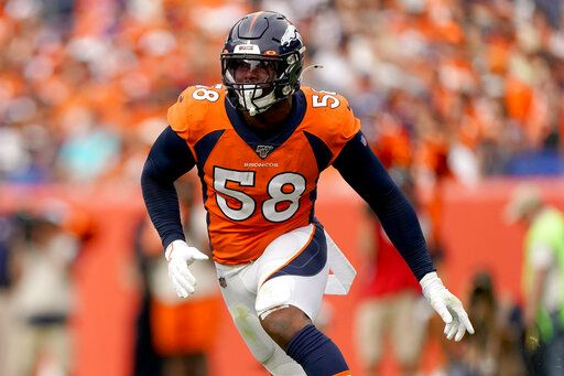 FILE - In this Sept. 15, 2019, file photo, Denver Broncos outside linebacker Von Miller (58) chases a play against the Chicago Bears during the second half of an NFL football game in Denver.  Von Miller is determined to show a so-so 2019 was an oddity, not an omen.
