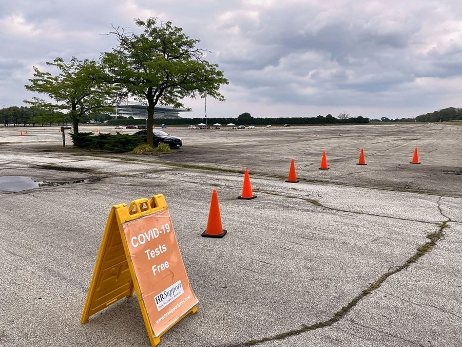 A COVID-19 testing site opened Monday in the parking lot of Arlington International Racecourse in Arlington Heights. It relocated from Rolling Meadows High School.