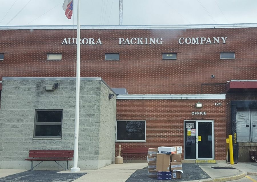 A wrongful death lawsuit seeks damages from the Aurora Packing Company after the wife of a longtime company butcher died of COVID-19 on May 2.