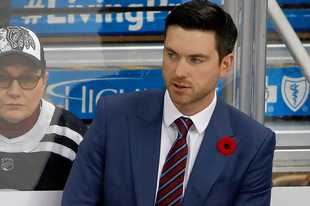 Chicago Blackhawks head coach Jeremy Colliton stands behind his bench during the first period of an NHL hockey game against the Pittsburgh Penguins in Pittsburgh, Saturday, Nov. 9, 2019. (AP Photo/Gene J. Puskar)