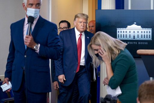 President Donald Trump returns to a news conference in the James Brady Press Briefing Room after he briefly left because of a security incident outside the fence of the White House, Monday, Aug. 10, 2020, in Washington.