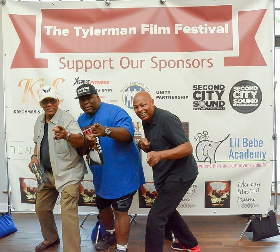 Andrew Tyler, center, a filmmaker and festival producer of the Tylerman Film Festival, is getting ready to put on his second annual event this weekend at Cantigny Park in Wheaton.
