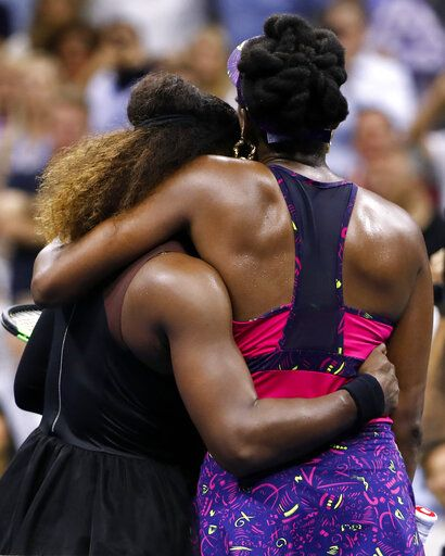 FILE - In this Friday, Aug. 31, 2018, file photo, Serena Williams, left, embraces her sister Venus Williams after their third-round match at the U.S. Open tennis tournament in New York. Serena Williams won 6-1, 6-2. The siblings meet each other for the 31st time when they take the court at a WTA tournament in Kentucky on Thursday, Aug. 13, 2020.