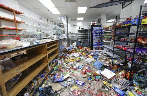 Food and other items are strewn on the floor of African Food & Liquor in Chicago, Thursday, Aug. 13, 2020. The West Side convenience store was ransacked Monday just hours after Chicago Mayor Lori Lightfoot warned vandals that the city will hold them accountable for ransacking downtown retailers earlier that day. It was the second time since May that the neighborhood store was vandalized.