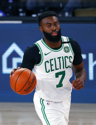 Boston Celtics' Jaylen Brown handles the ball during the second half of an NBA basketball game against the Memphis Grizzlies  Tuesday, Aug. 11, 2020, in Lake Buena Vista, Fla.