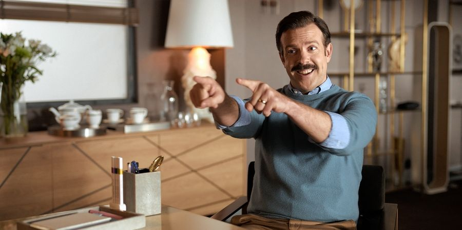 """An American football coach (Jason Sudeikis) takes on an English soccer team in """"Ted Lasso,"""" premiering Friday, Aug. 14, on Apple TV+."""
