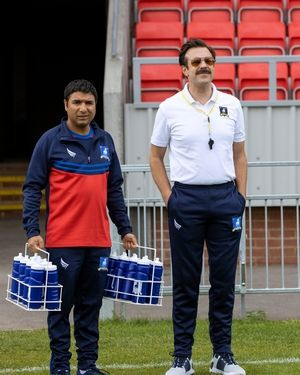 """An American football coach (Jason Sudeikis), right, moves to England to take on a new challenge in """"Ted Lasso,"""" on Apple TV+. The comedy also stars Nick Mohammed."""
