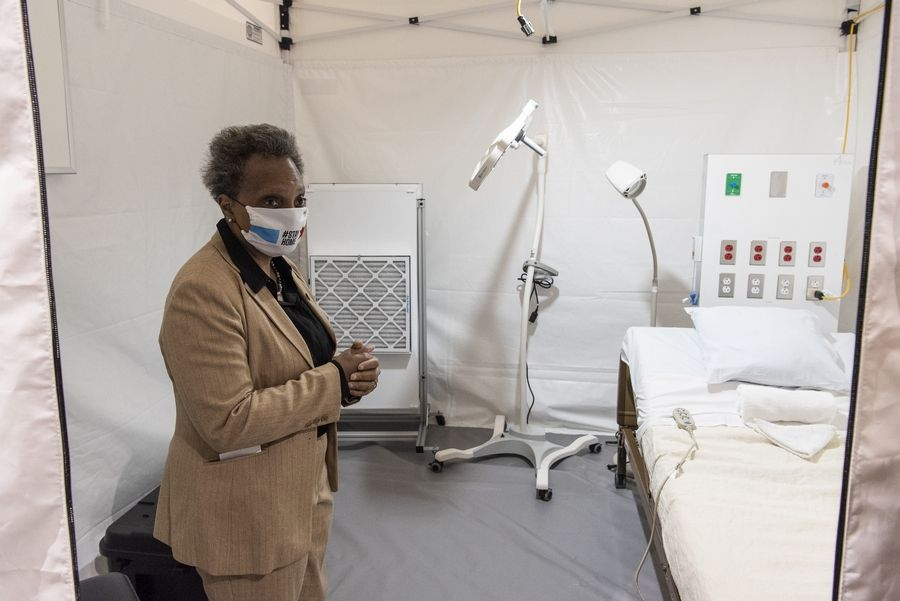 Chicago Mayor Lori Lightfoot views one of the patient rooms at the COVID-19 field hospital at McCormick Place in April.