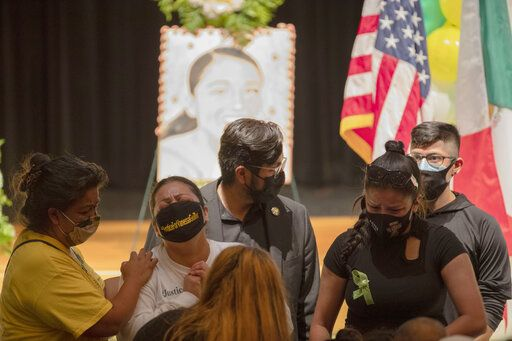 A family member of Army Spc. Vanessa Guillen, her Aunt Alma Garcia, second from left, becomes emotional at the public memorial service for Guillen on Friday, Aug. 14, 2020, in Houston. Guillen, who was last seen on April 22, was laid to rest nearly four months after she is said to have been killed by a fellow soldier at Fort Hood, a U.S. Army base in Texas. (Marie D. De Jesus/Houston Chronicle via AP)