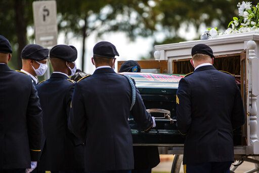 The casket of Army Specialist Vanessa Guillen is removed from a carriage to take it to a memorial service in honor of the soldier at Cesar Chavez High School Friday, Aug. 14, 2020, in Houston. Guillen, who was last seen on April 22, was laid to rest nearly four months after she is said to have been killed by a fellow soldier at Fort Hood, a U.S. Army base in Texas. Mourners gathered at the high school where Guillen grew up playing soccer and dreaming of joining the military. (Marie D. De Jesus/Houston Chronicle via AP)