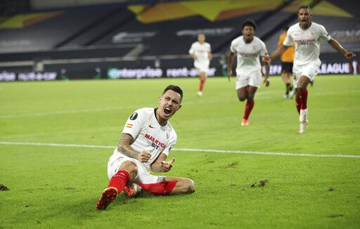 Sevilla's Lucas Ocampos celebrates after scoring his side's opening goal during the Europa League quarterfinal soccer match between Wolves and Sevilla at the MSV Arena in Duisburg, Germany, Tuesday, Aug. 11, 2020. (Friedemann Vogel, Pool Photo via AP)