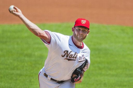 Washington Nationals starting pitcher Stephen Strasburg throws during the first inning of a baseball game against the Baltimore Orioles in Washington, Sunday, Aug. 9, 2020.