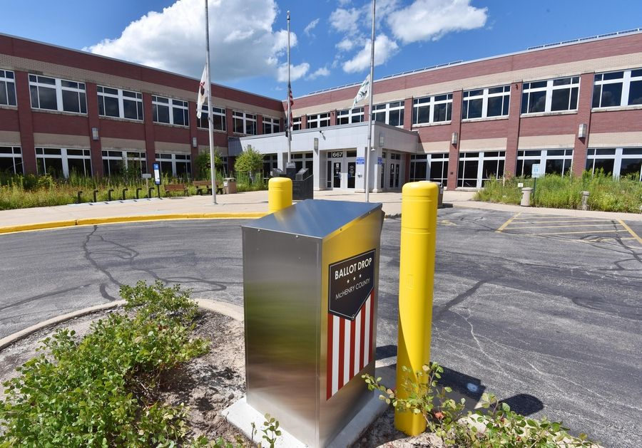 With concerns rising over the U.S. Postal Service's ability to handle a crush of mail ballots this fall, suburban counties are installing dozens of secure drop boxes across the region. This one is outside the McHenry County administration building in Woodstock.