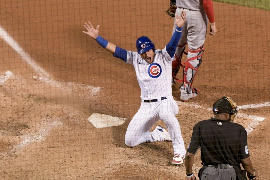 Chicago Cubs Willson Contreras (40) celebrates after scoring on a triple by teammate Jason Heyward during the fourth inning of a baseball game against the St. Louis Cardinals Tuesday, Aug. 18, 2020, in Chicago.