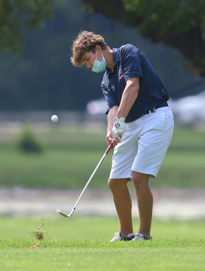 St. Viator's Benny Wozniak hits an approach shot at St. Andrews Golf Club in West Chicago on Saturday. Wozniak is part of a St. Viator team with a record 36 players.