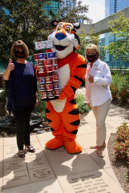 Tony the Tiger joined Sheila Musolino (LEFT), President and Chief Executive Officer, Ronald McDonald House Charities and Wendy Davidson (RIGHT), President of Kellogg's Away From Home to kick off the Kellogg cereal donor program which will deliver complimentary breakfasts for years to come to parents staying at a Ronald McDonald House while their child is receiving treatment at a nearby hospital.Kellogg's Away From Home