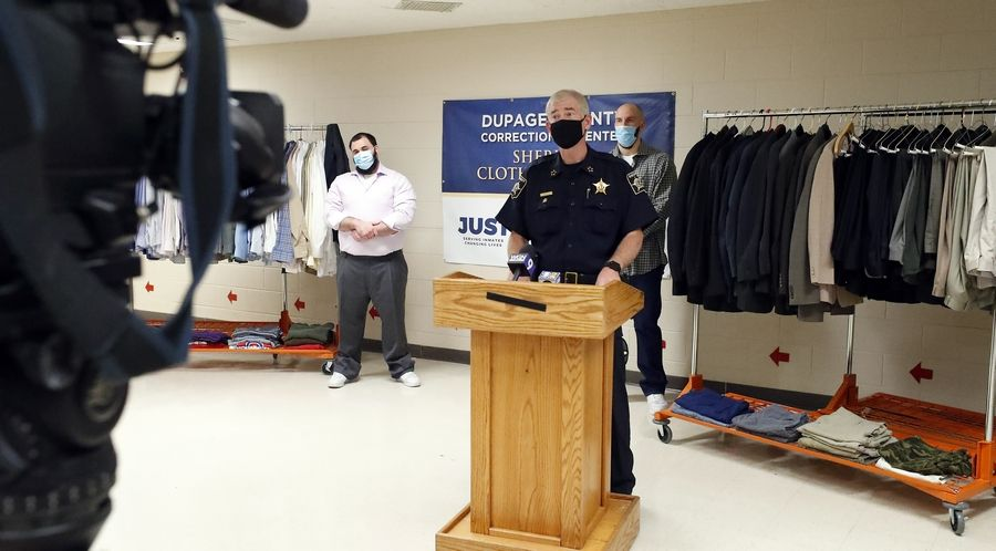 DuPage County Sheriff James Mendrick announces that Naperville-based nonprofit Suits for Success is donating 400 pieces of dress and casual men's clothing to assist detainees when they are released. Detainees Sean Falcone, left, and Gregory Fischer modeled some of the items.