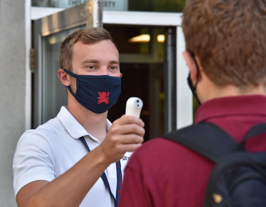 Temperature and symptom checks greeted St. Viator High School students Monday as the school held its first day of in-person classes for the school year.