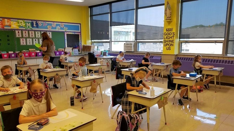 Desks spaced farther apart and a mask requirement are among the safety measures being taken at Our Lady of the Wayside School in Arlington Heights, which welcomed students back Monday for the first full day of in-person learning.