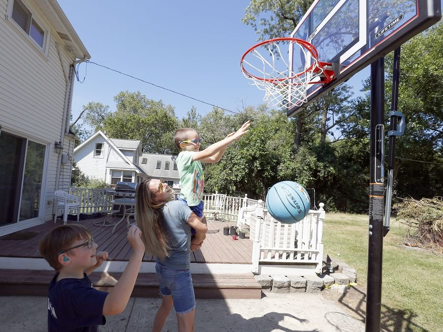 Wheaton resident Rachel Heneghan has two sons, Aidyn, 9, left, and Logan, 7, with varying degrees of deafness. Heneghan is frustrated that special-needs students might not adjust to the changes this fall to in-person instruction.