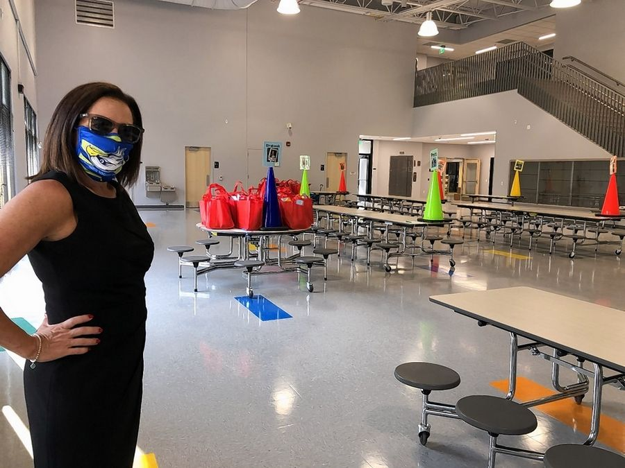 Principal Jill Martin leads visitors through the new $13.5 million Hawthorn School for Young Learners in Vernon Hills.
