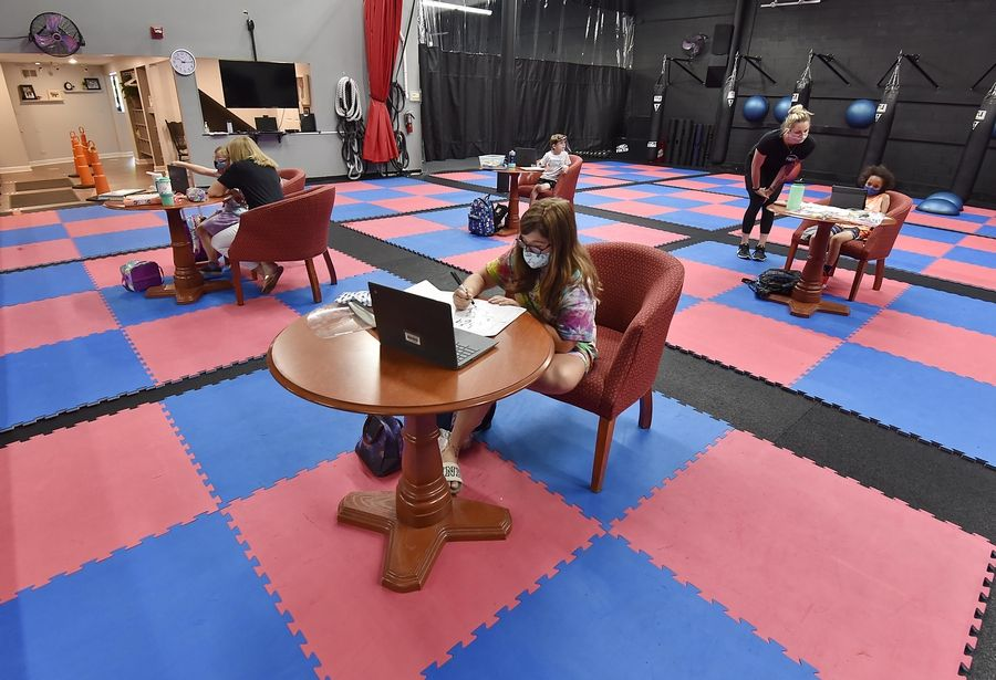 Situated within 10-by-10-foot pods, students begin their first day of virtual classes Monday at Focus Martial Arts & Fitness in Lake in the Hills. It's one of a number of gyms and other nontraditional learning spaces that have begun hosting students for remote learning.