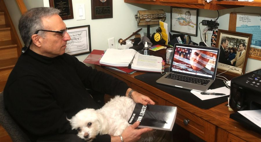 "Former CIA agent Joe Goldberg is set to teach a new course called ""Fake News & The Search for Truth in Today's Media"" for the College of DuPage. Goldberg, pictured with his dog, Ollie, also is author of the self-published 2014 fictional thriller ""Secret Wars: An Espionage Story."""