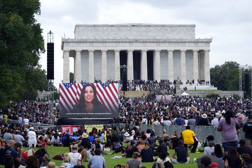 "A screen displays a video with Democratic vice presidential candidate Kamala Harris speaking during the March on Washington, Friday Aug. 28, 2020, at the Lincoln Memorial in Washington, on the 57th anniversary of the Rev. Martin Luther King Jr.'s ""I Have A Dream"" speech."