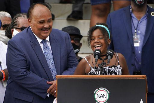 Yolanda Renee King, granddaughter of Martin Luther King Jr., speaks at the March on Washington, Friday Aug. 28, 2020, at the Lincoln Memorial in Washington. At left is her father Martin Luther King, III.