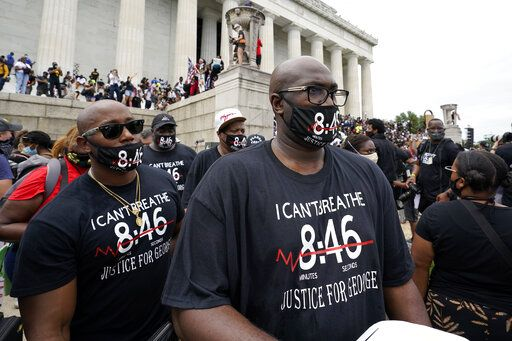 Philonise Floyd, right, brother of George Floyd, gets ready to march from the Lincoln Memorial to the Martin Luther King Jr. Memorial during the March on Washington, Friday Aug. 28, 2020, in Washington.