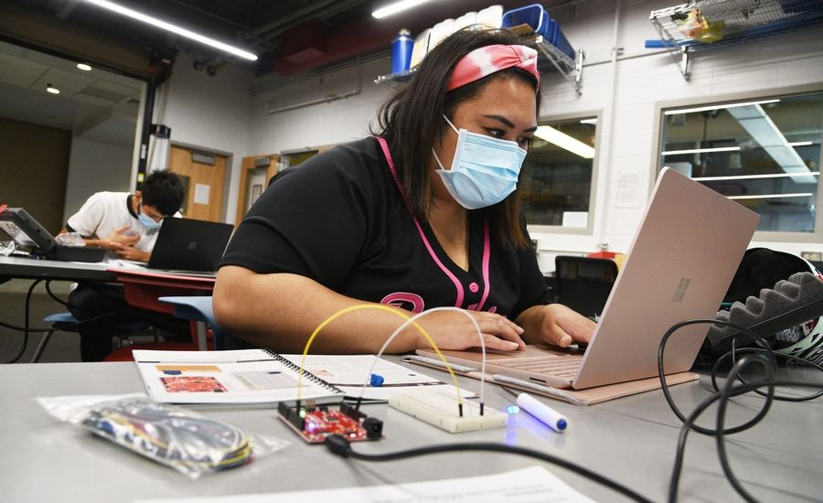 "Sam Campos, of Wadsworth, attends an in-person class Wednesday at College of Lake County's Grayslake campus. A small number of students in the ""How to Make Almost Anything"" class in the technology building were distanced and masked during the class."