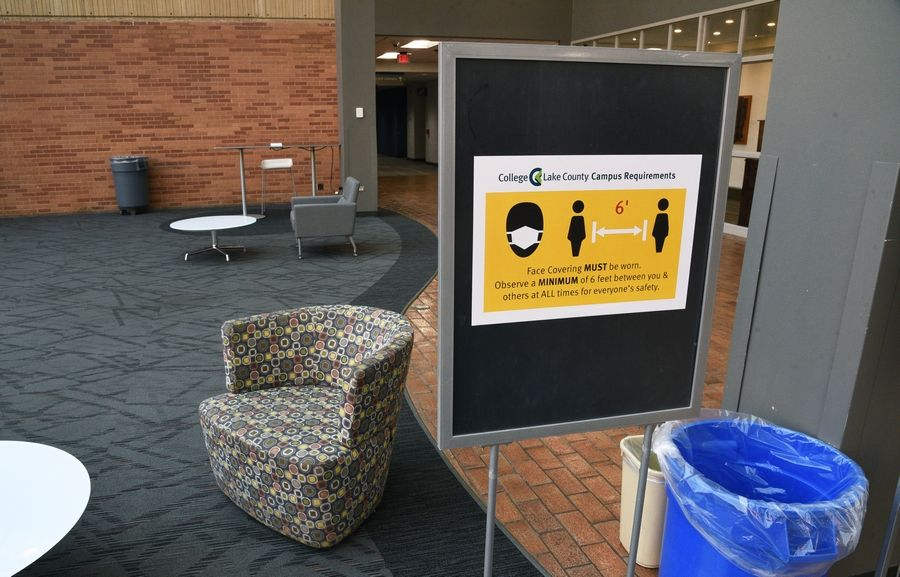 Signs are posted at College of Lake County in Grayslake as a reminder to keep socially distant while in the buildings. Chairs have been spaced out, with some being removed, in the common areas.