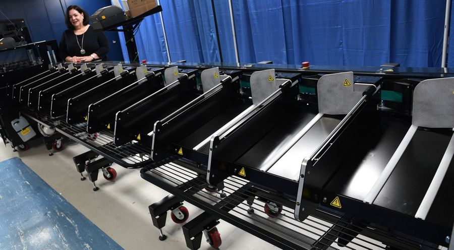 New equipment installed at DuPage County allows mail-in ballots to be sorted into batches so they can be counted at a different time. The new machine also authenticates signatures.