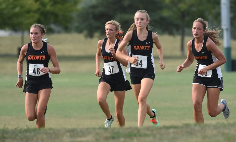 The St. Charles East runners from left Marley Andelman (48), Ava Abbott (47), Morgan Sandlund (54) and Mackenzie Loomis dominated Monday's girls cross county meet against Glenbard North, Geneva and Lake Park at Camera Park in Glendale Heights. Andelman finished in first place followed by Sandlund.