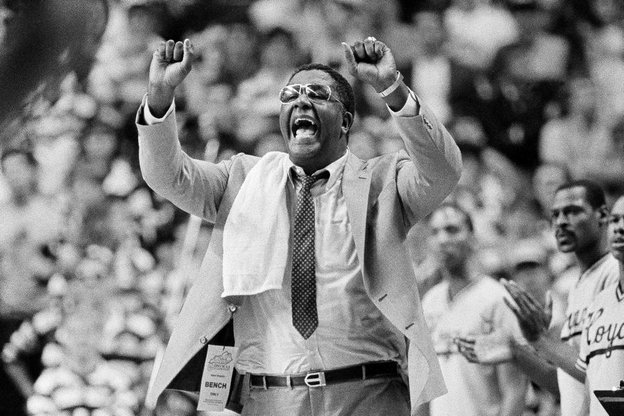 "FILE -- In this March 30, 1985, file photo, Georgetown coach John Thompson shouts to the floor during the Hova's NCAA semifinal game against St. John's at Rudo Arena in Lexington, Ky. John Thompson, the imposing Hall of Famer who turned Georgetown into a ""Hoya Paranoia"" powerhouse and became the first Black coach to lead a team to the NCAA men's basketball championship, has died. He was 78 His death was announced in a family statement Monday., Aug. 31, 2020. No details were disclosed."