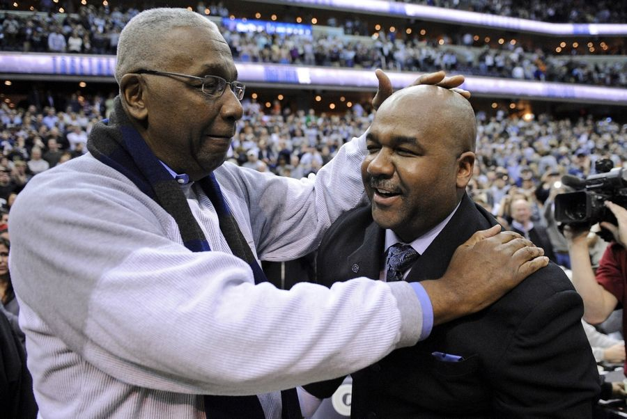 "FILE -- In this March 9, 2013, file photo, former Georgetown coach John Thompson Jr., left, congratulates his son Georgetown head coach John Thompson III, right, after the Hoya's 61-39 win over Syracuse in an NCAA college basketball game in Washington. John Thompson, the imposing Hall of Famer who turned Georgetown into a ""Hoya Paranoia"" powerhouse and became the first Black coach to lead a team to the NCAA men's basketball championship, has died. He was 78 His death was announced in a family statement Monday., Aug. 31, 2020. No details were disclosed."
