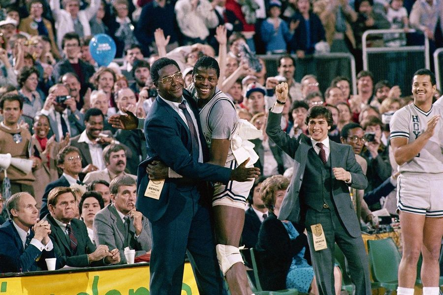 "FILE -- In this April 2, 1984, file photo, Georgetown head coach John Thompson, left, gives a happy pat to the most valuable player Patrick Ewing, after Georgetown defeated Houston 84-75 in Seattle. John Thompson, the imposing Hall of Famer who turned Georgetown into a ""Hoya Paranoia"" powerhouse and became the first Black coach to lead a team to the NCAA men's basketball championship, has died. He was 78 His death was announced in a family statement Monday., Aug. 31, 2020. No details were disclosed."