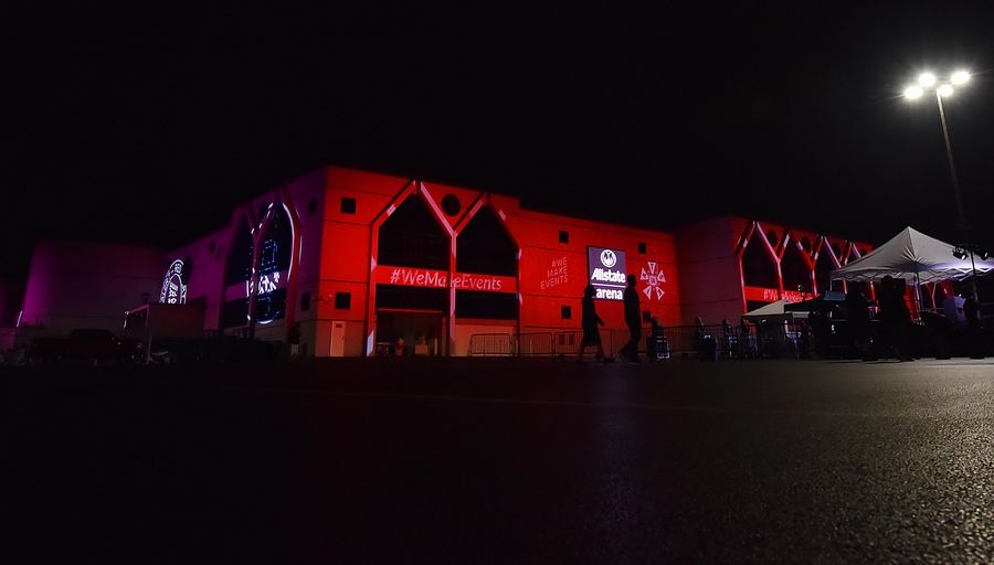 John Starks/jstarks@dailyherald.comIn preparation for an event, the Allstate Arena is lit with red lights Tuesday night to raise awareness of the COVID-19 devastation on the entertainment industry.
