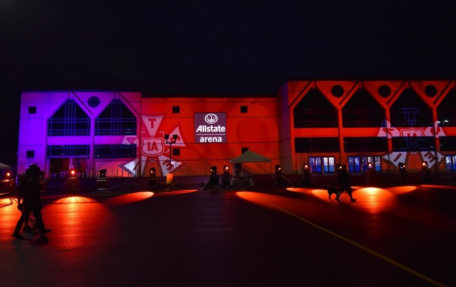 John Starks/jstarks@dailyherald.comAllstate Arena is lit with red lights Tuesday night to raise awareness of the COVID-19 devastation on the entertainment industry.
