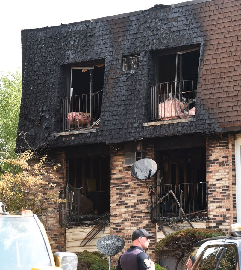 Heavy damage is visible the day after an explosion and fire in an apartment on South Waters Edge Drive in Glendale Heights. Two people were found dead after the fire.
