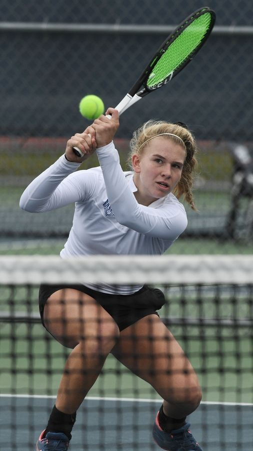 Lakes' Megan Heuser plays the ball at the net during the girls state tennis Class 1A championship at Buffalo Grove High School last year.