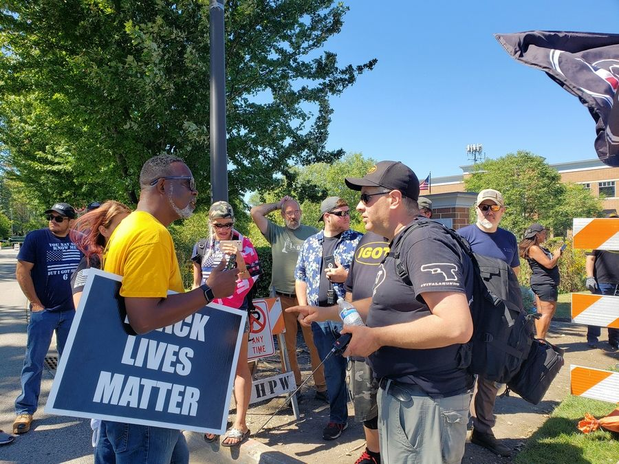 An unidentified Black Lives Matter supporter exchanges words with Carl Arriaza, who organized a rally Saturday in support of Kyle Rittenhouse of Antioch.