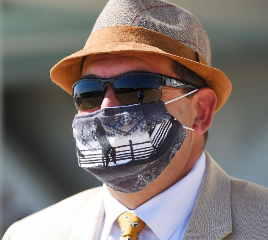 Arlington Heights Trustee John Scaletta wears a horse face mask for The Derby Day celebration at the track.