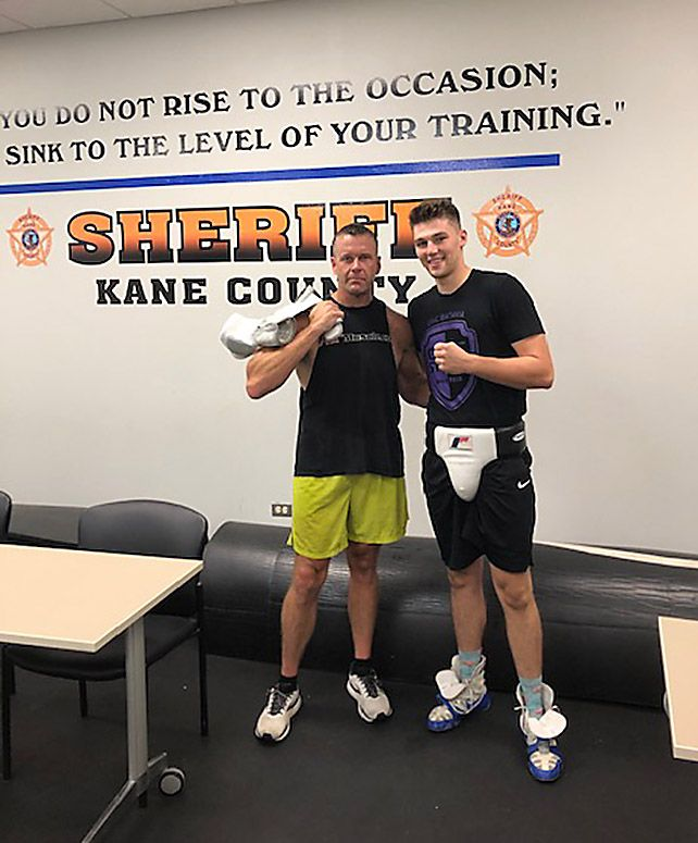 Kane County Sheriff Ron Hain, left, is pictured with sparring partner Zach Douglas, the 2019 state boxing champ. Hain will take on Marcus Banner of Elgin in a charity boxing match Saturday in Elgin.