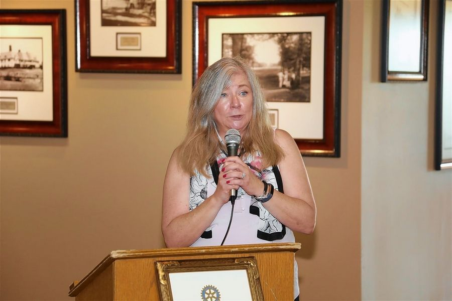 Paula Nugent, the president of the Glen Ellyn Food Pantry board, thanks the Rotary Club for a $25,000 donation to fundraising efforts for a new home for the nonprofit group.